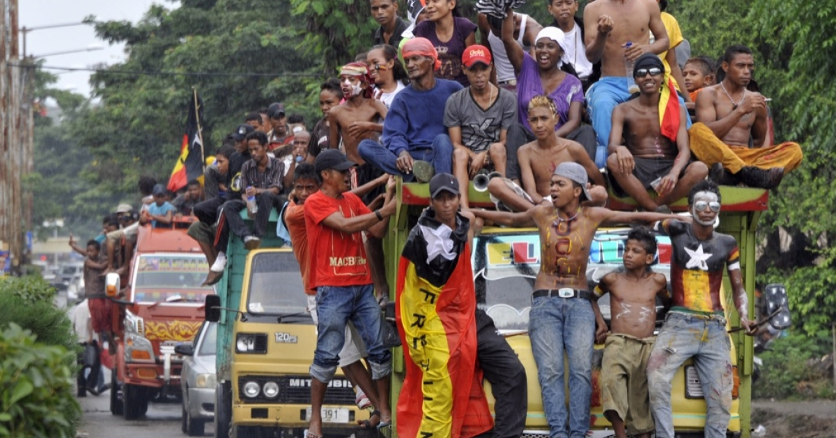 Fretilin party supporters ride in a caravan as they campaign for their presidential bet Fernando 'Lu Olo' Guterres, a former guerrilla commander, on March 14, 2012. East Timor was officially recognized as independent in 2002 after 24 years of brutal Indonesian occupation.</p>