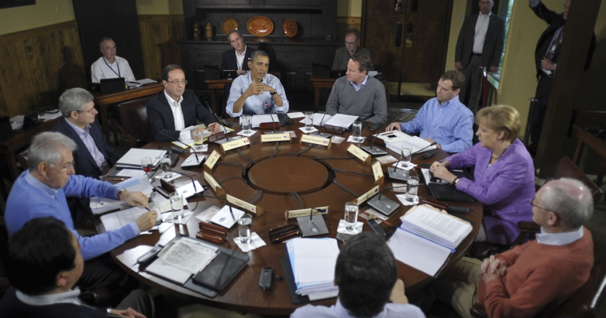 US President Barack Obama chairs a G8 summit session on May 19, 2012, at the Camp David presidential retreat in Maryland.</p>