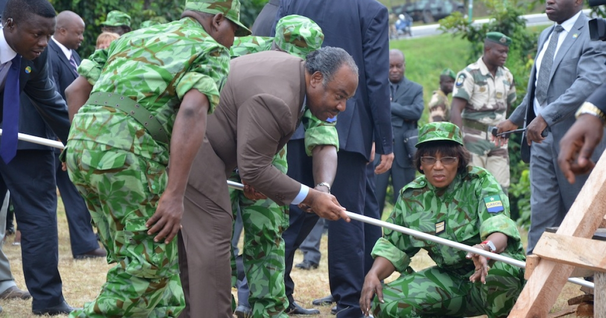 Gabonese President Ali Bongo (C) gets ready to set fire to five tons of ivory worth $9.3 million on June 27, 2011 in Libreville to mark his government's commitment to battling poachers and saving elephants.</p>