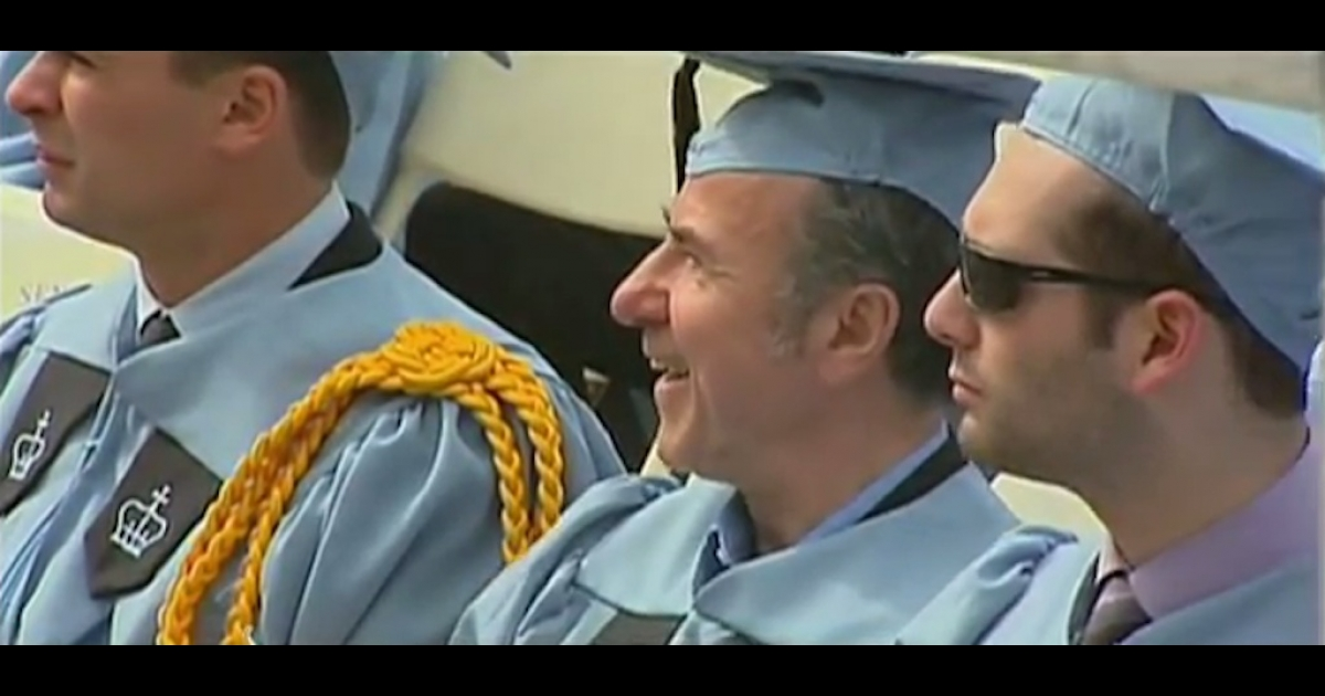 Gac Filipaj (middle), 52, a janitor at Columbia University, graduated from the Ivy Leagues school on Sunday with a bachelor's degree in classics with honors after 12 years of study.</p>