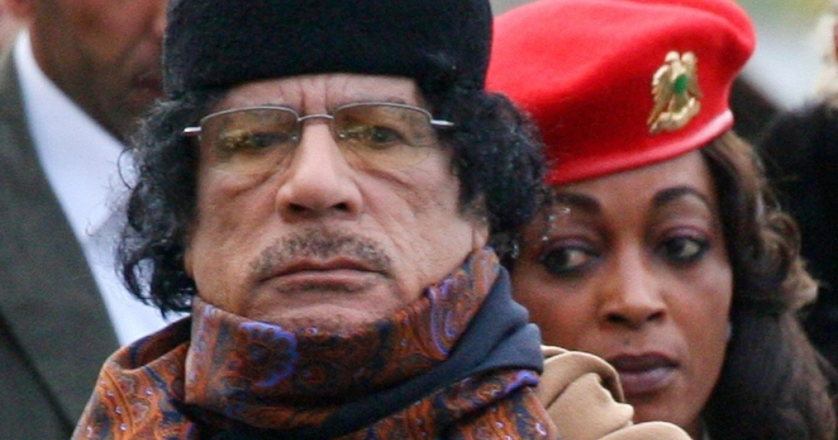 Libyan leader Muammar Gaddafi, left, with one of his female bodyguards by his side. There is considerable speculation that Gaddafi is relying upon African mercenary soldiers to prop up his embattled regime.</p>