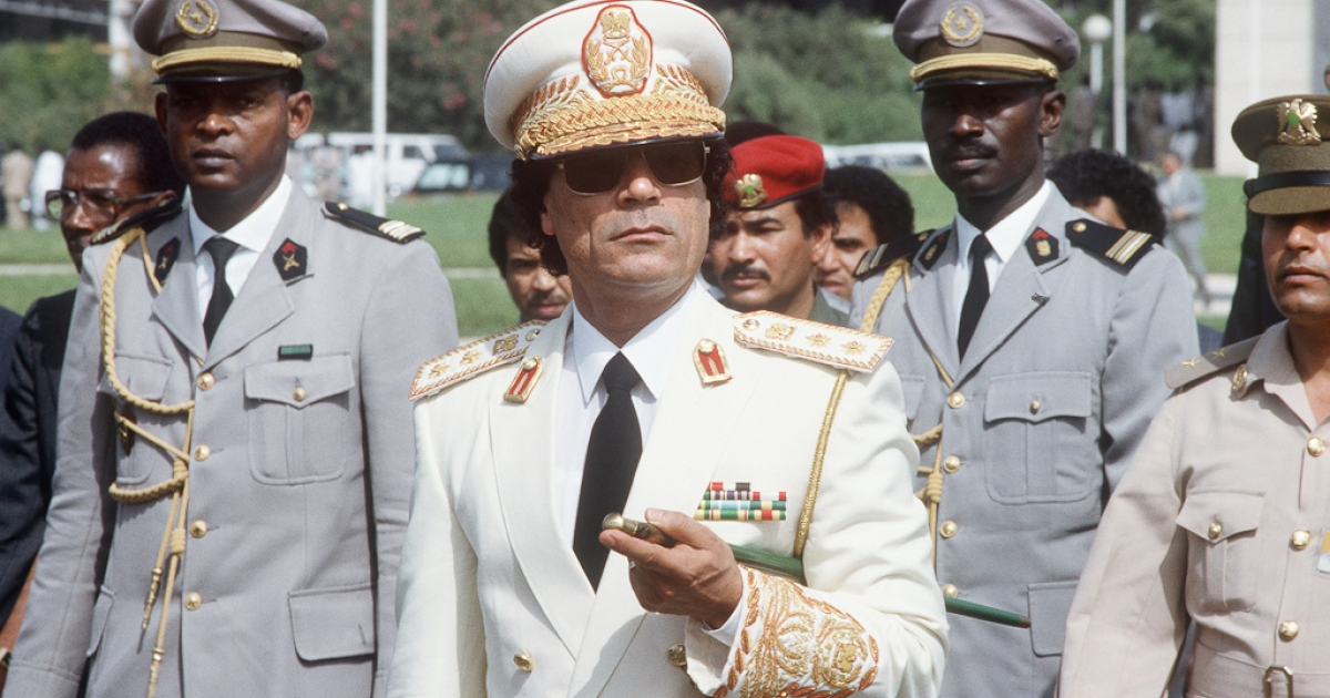 Libyan Head of State Colonel Muammar Gaddafi reviews troops in Dakar upon his arrival for three-day official visit to Senegal. Dec. 03, 1985.</p>