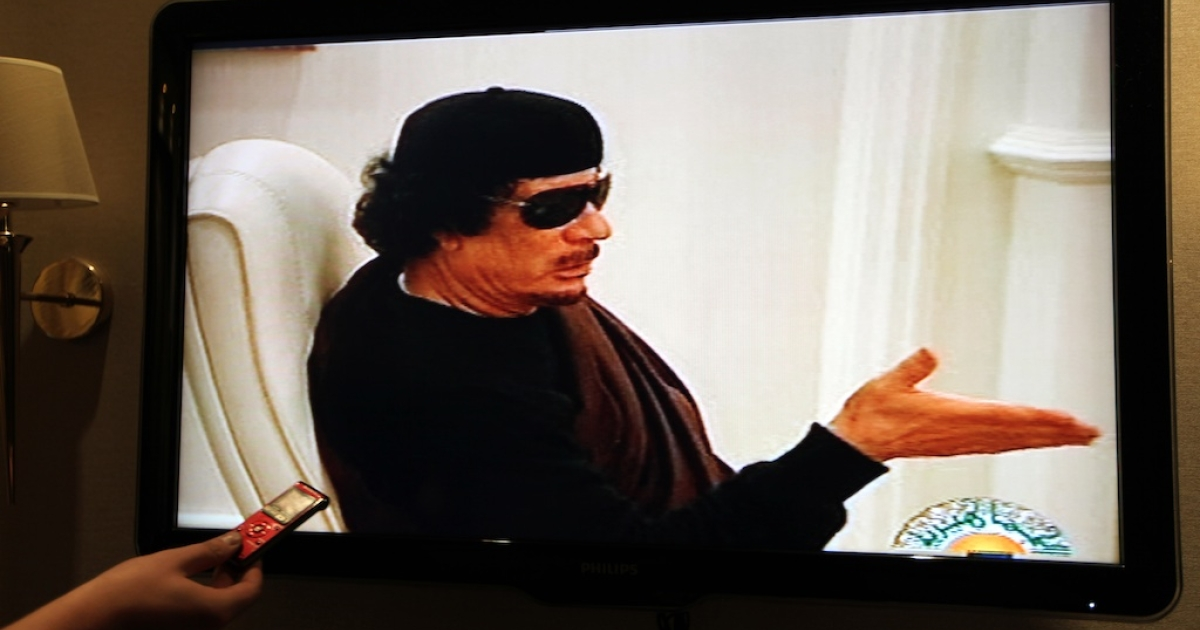 A picture taken in Gaza City on May 11, 2011, shows Libyan state TV showing footage of Muammar Gaddafi in a meeting.</p>