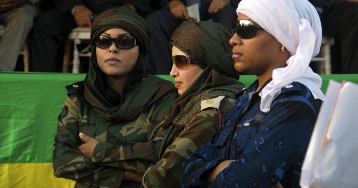 The female bodyguards of Libyan Col. Muammar Gaddafi stand in front of the stage in Dakar, Senegal during the World Festival of Black Arts and Culture.</p>