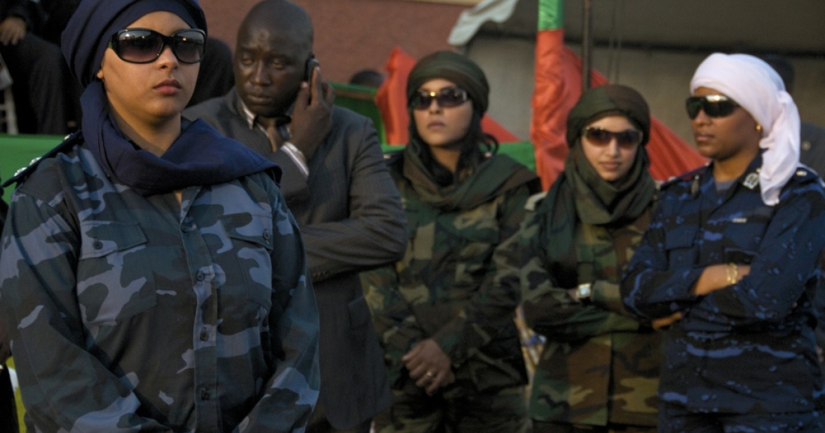 The four female bodyguards traveling with Gaddafi stood below the stage as he spoke at the World Festival of Black Arts and Culture in Dakar this past December.</p>