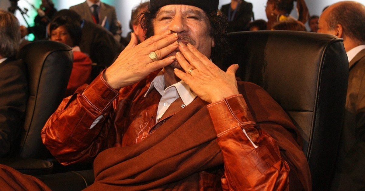 Before his downfall, Libyan leader Muammar Gaddafi blows kisses to journalists at the Europe-Africa summit on December 8, 2007, in Lisbon.</p>