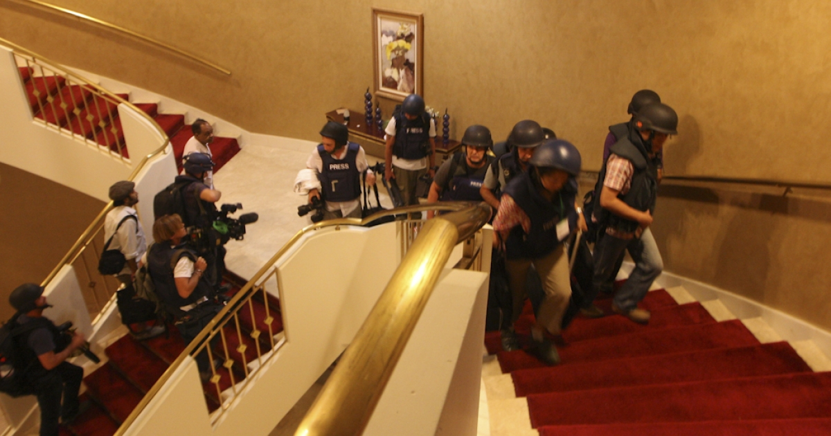Foreign journalists in protective gear are seen climbing the stairs at the Rixos hotel where they were confined, as rebel forces overran Libyan leader Muammar al-Gaddafi's fortified Bab al-Azizya headquarters in the capital Tripoli following heavy fighting on August 23, 2011. The journalists were freed from the Rixos hotel on August 24, 2011, after being held for nearly six days.</p>