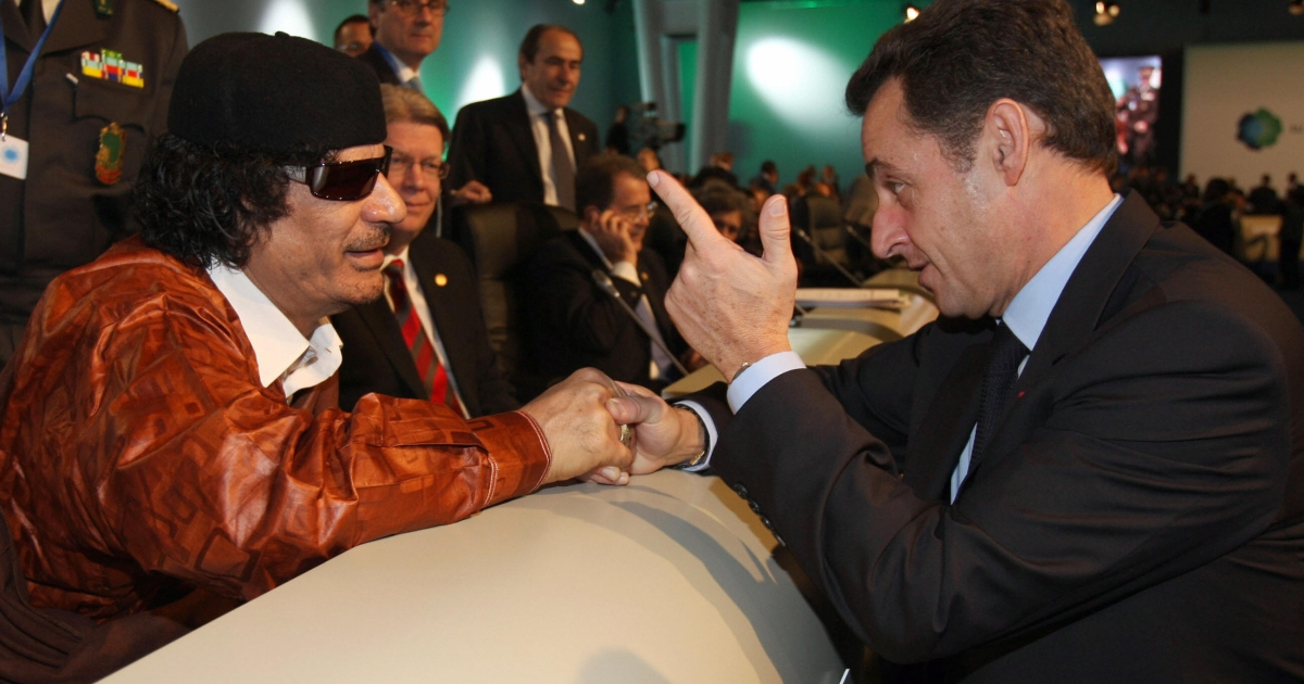 Sarkozy chats with Gaddafi prior the first working session of a European Union and Africa summit in December, 2007 in Lisbon, Portugal.</p>