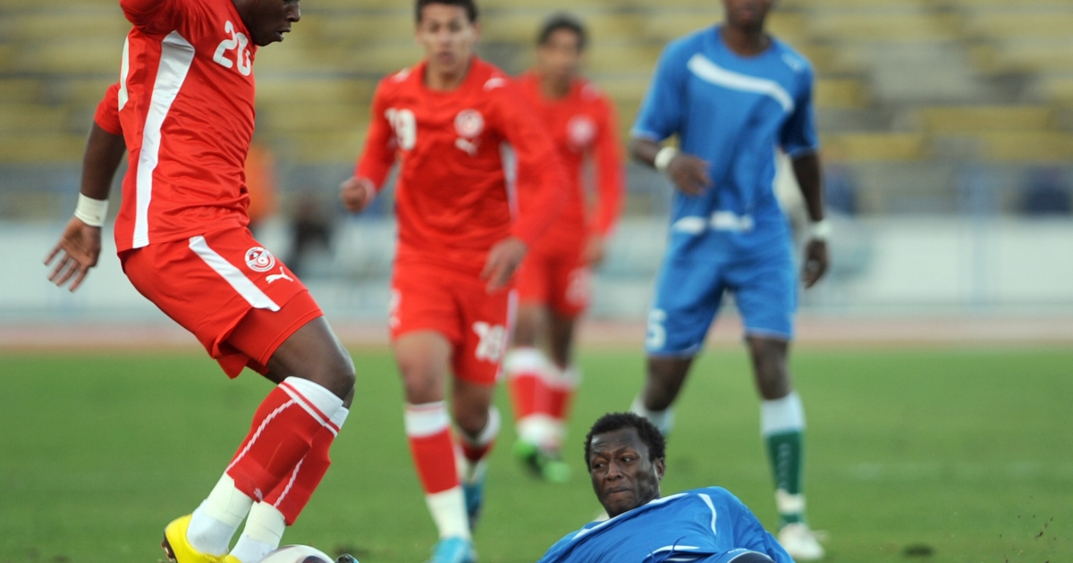 Tunisian player Mohamed Ali Nafkha (L) vies with Gambia's Sanney Nyassi (R) during a friendly football match on January 9, 2010.  FIFA has threatened to impose sanctions upon The Gambia after the government replaced elected football officials with an appointed 12-month committee.</p>