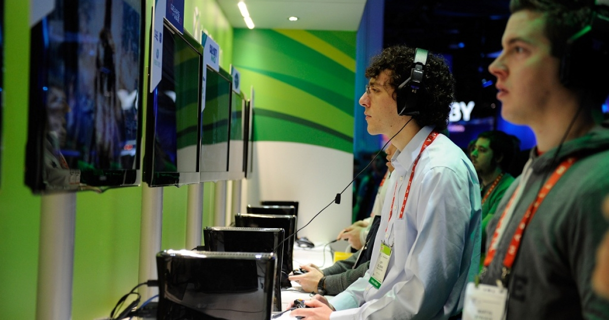 Attendees play video games at Microsoft's Xbox 360 display at the 2012 International Consumer Electronics Show at the Las Vegas Convention Center January 10, 2012 in Las Vegas, Nevada. CES, the world's largest annual consumer technology trade show, runs through January 13 and is expected to feature 2,700 exhibitors showing off their latest products and services to about 140,000 attendees.</p>