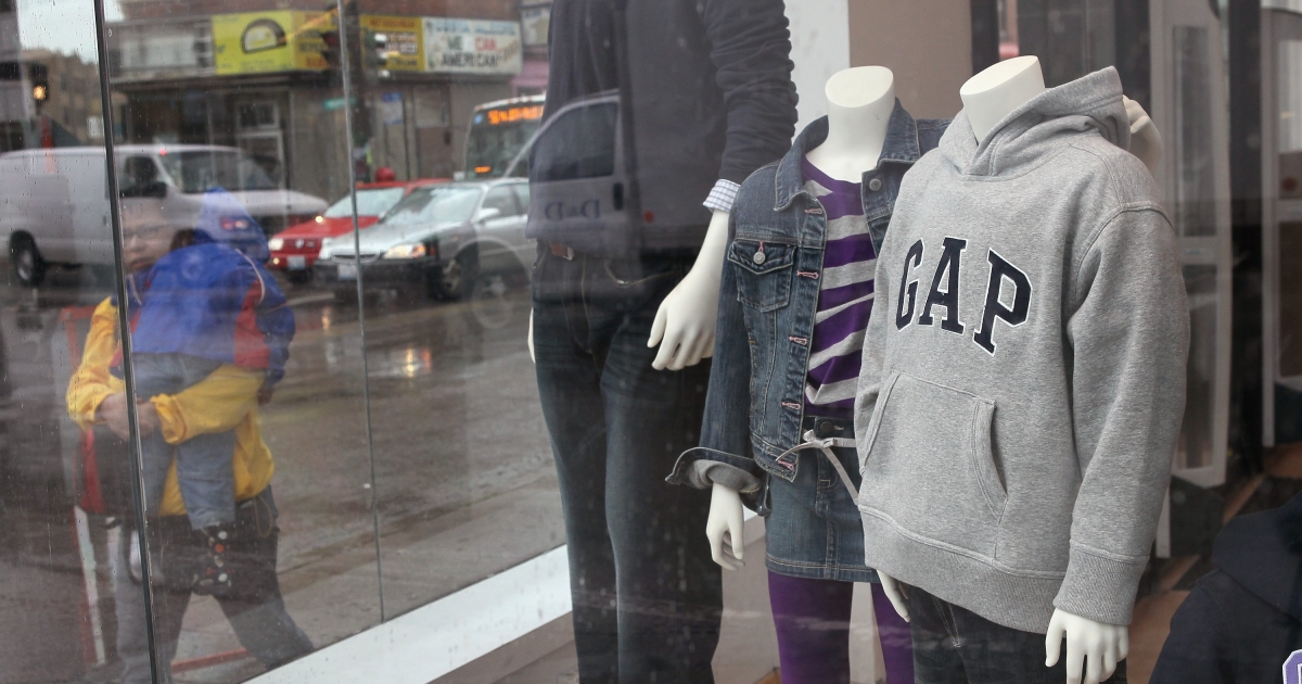 Mannequins in the window of a Gap store in Chicago, Ill., on Oct. 13, 2011. Gap Inc. plans to reduce the number of Gap brand stores to 700 in North America, closing 21 percent of their existing stores by the end of 2013.</p>