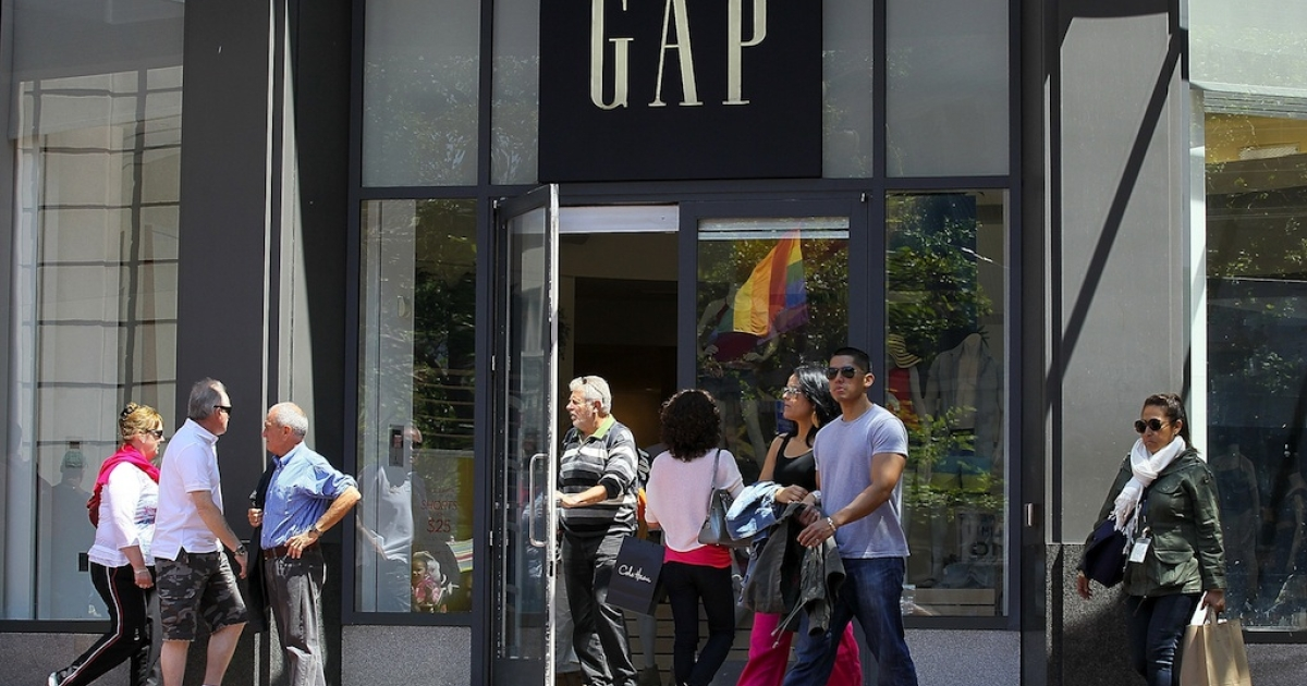 Pedestrians walk by a Gap store in San Francisco on May 19, 2011.</p>