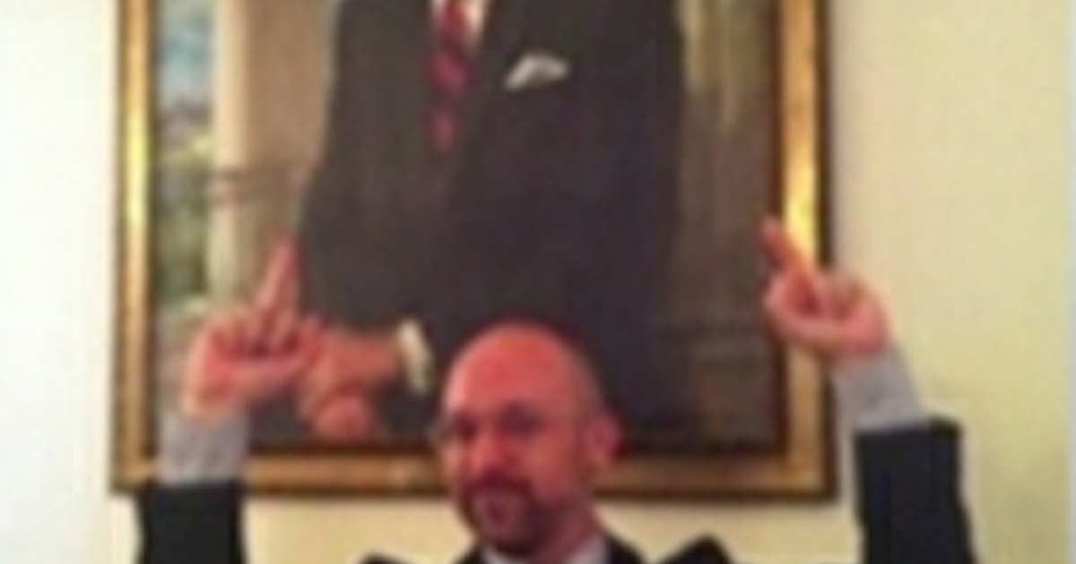 White House guest Matty Hart is seen flipping off a portrait of Ronald Reagan on June 15, 2012.</p>