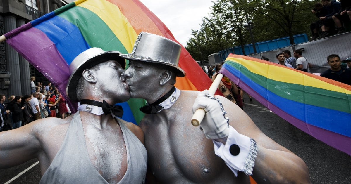 Men kiss during the Stockholm Pride parade in central Stockholm on Aug. 6, 2011.</p>