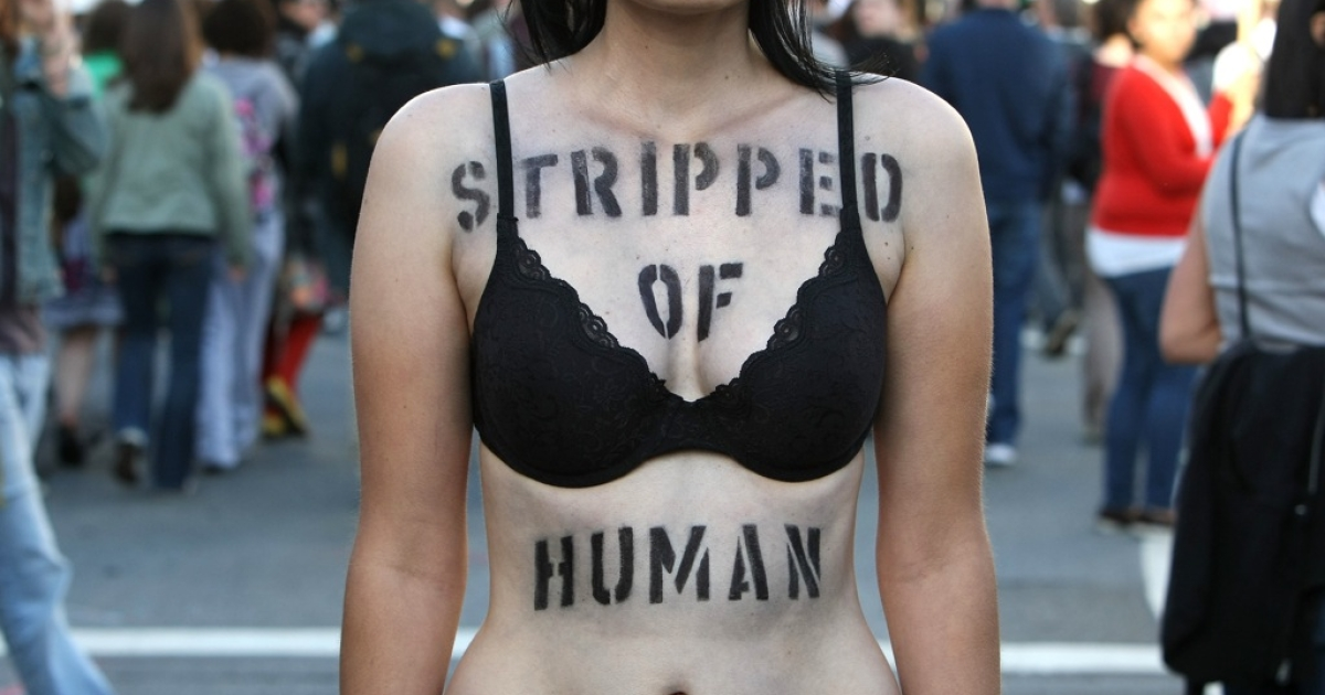 Helaine Gawlica stands with a spray painted message on her body during a march and rally following the California Supreme Court's ruling to uphold Proposition 8 May 26, 2009 in San Francisco, California. Civil rights for the LGBT community has largely fell to the states with anti-discrimination and legal rights for gays and lesbians largely varying statewide.</p>