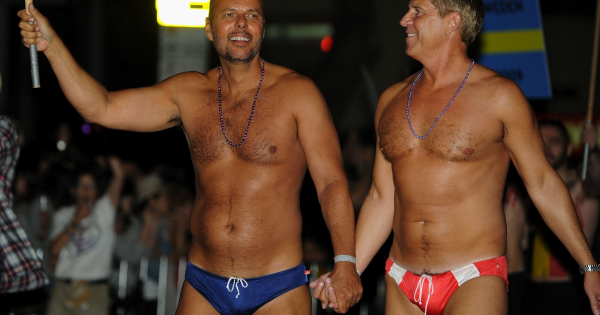 Participants march during the 34th annual Gay and Lesbian Mardi Gras Parade in Sydney on March 5, 2011.</p>