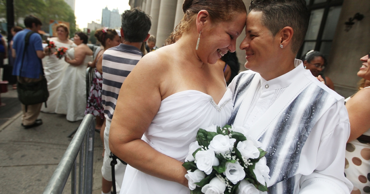 Maira Garcia and Maria Vargas wait on line to get married at the Brooklyn City Clerk's office in New York City. Hawaii is set to become the 15th US state to allow gay marriage after its senate passed the bill on Nov. 12, 2013.</p>