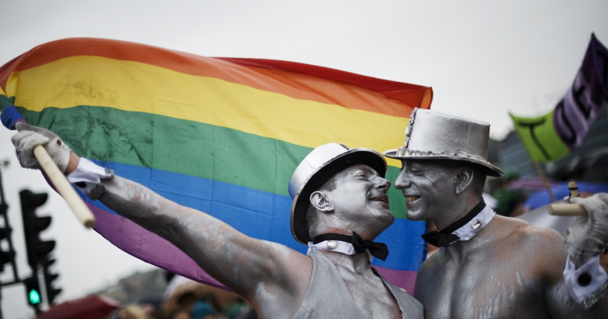 Men kiss during a gay pride parade. Dr. Robert Spitzer, the founder of the