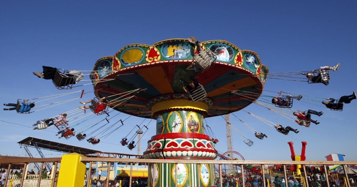 Palestinians at an amusement park in Gaza City.</p>