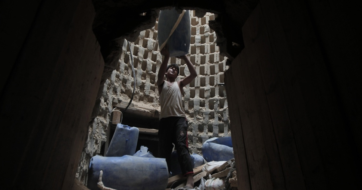 A Palestinian smuggler in a tunnel along the Gaza-Egypt border.</p>