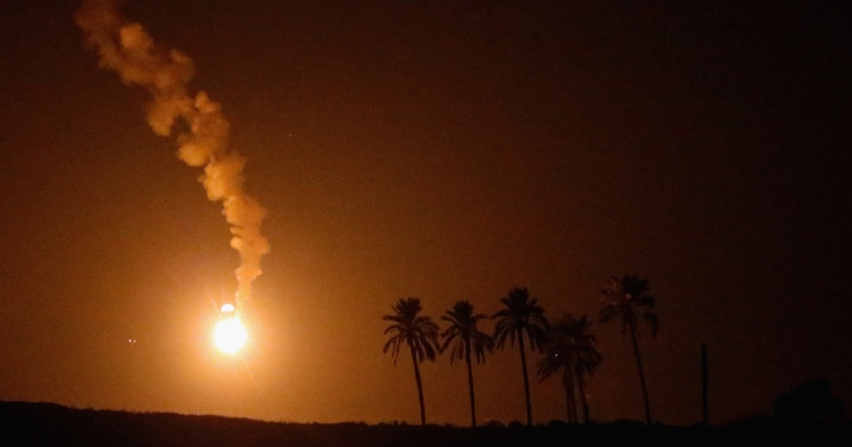 Parachute flares illuminate the Gaza Strip in preparation for an Israeli artillery barrage.</p>