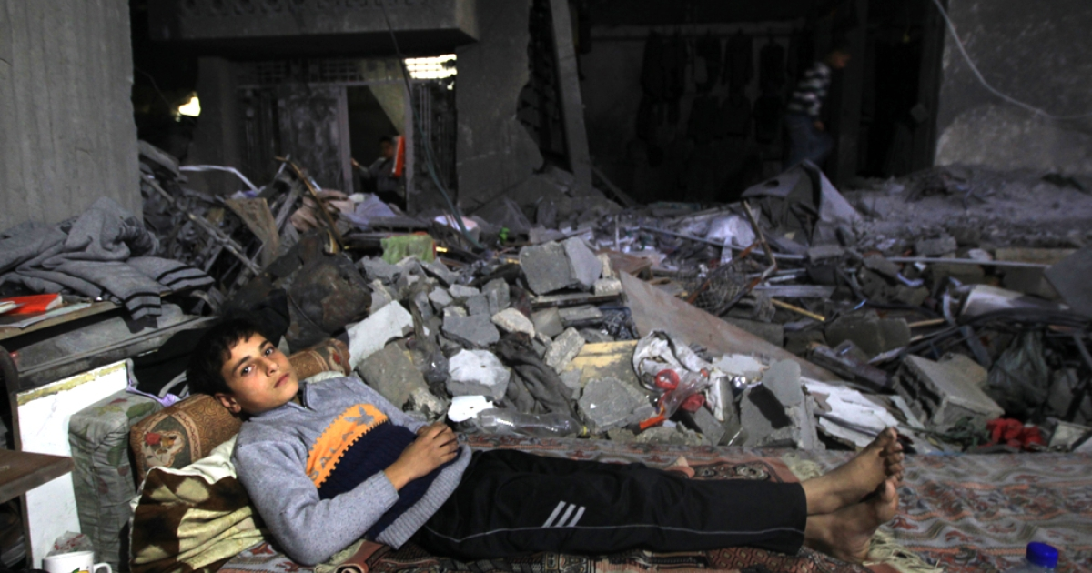 A boy rests on a mattress laid out in the rubble of a destroyed building in Beit Lahia, in the northern Gaza Strip, on November 26, 2012, following a truce last week between Israel and Hamas that ended eight days of conflict in which 166 Palestinians and six Israelis were killed. Hamas and Israel have begun indirect talks to implement the ceasefire.</p>