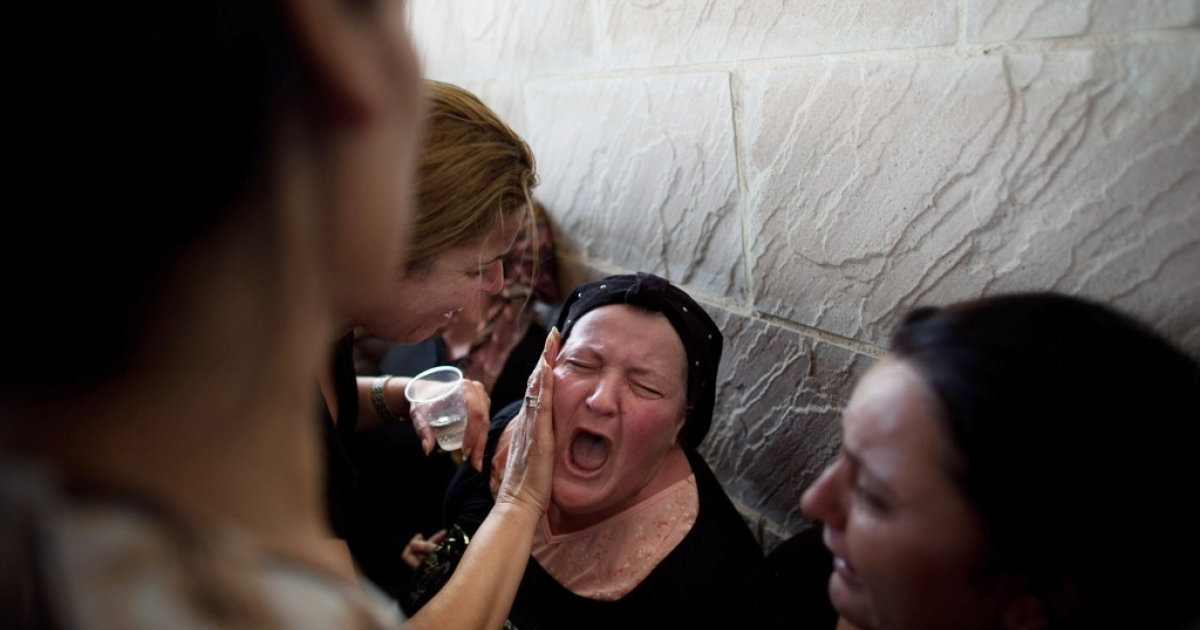 Family members grieve at a funeral in Kiryat Malachi, Israel on November 16, 2012. Three people were killed in Israel November 15, after a building was hit by a rocket fired from the Hamas-ruled Gaza Strip. Palestinian rocket attacks followed a series aerial strikes on targets in Gaza launched by Israeli Defense Forces (IDF) which killed a top military commander of Hamas.</p>