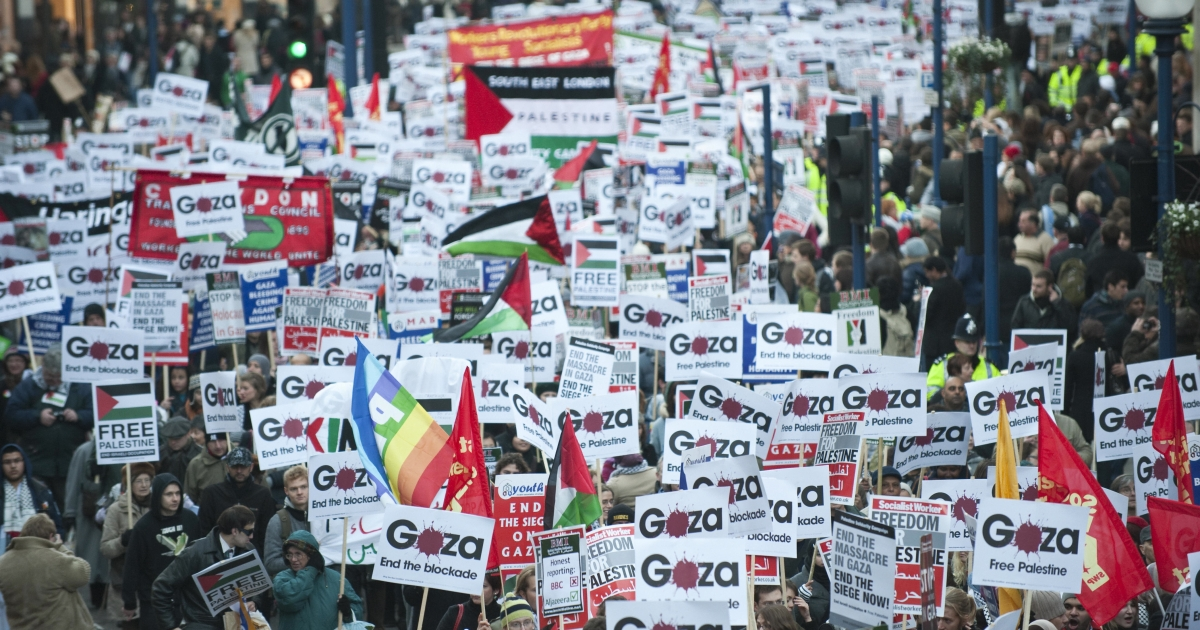 Protesters march in London to call attention to the plight of the Gaza Strip.</p>