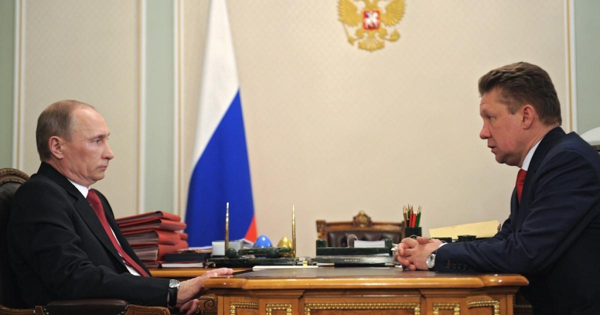 Vladimir Putin (L) speaks with CEO of Russian gas giant Gazprom Alexey Miller during their meeting in Putin's Novo-Ogaryovo residence outside Moscow, on Dec. 30, 2011.</p>