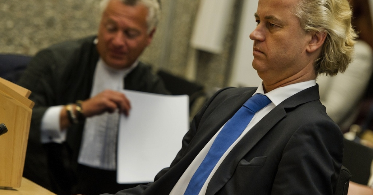 Dutch anti-Islam deputy Geert Wilders (R) sits next to his lawyer Bram Moszkowicz on May 23, 2011 in court in Amsterdam. The leader of the far-right Party for Freedom (PVV) faced five counts of giving offence to Muslims and of inciting hatred against Muslims and people of non-Western immigrant origin, particularly Moroccans.</p>
