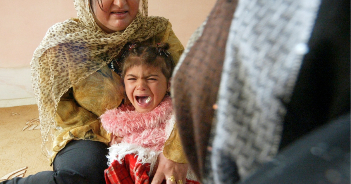 Iraqi Kurdish four-year-old Shwen screams during her circumcision in Iraq in 2009.</p>
