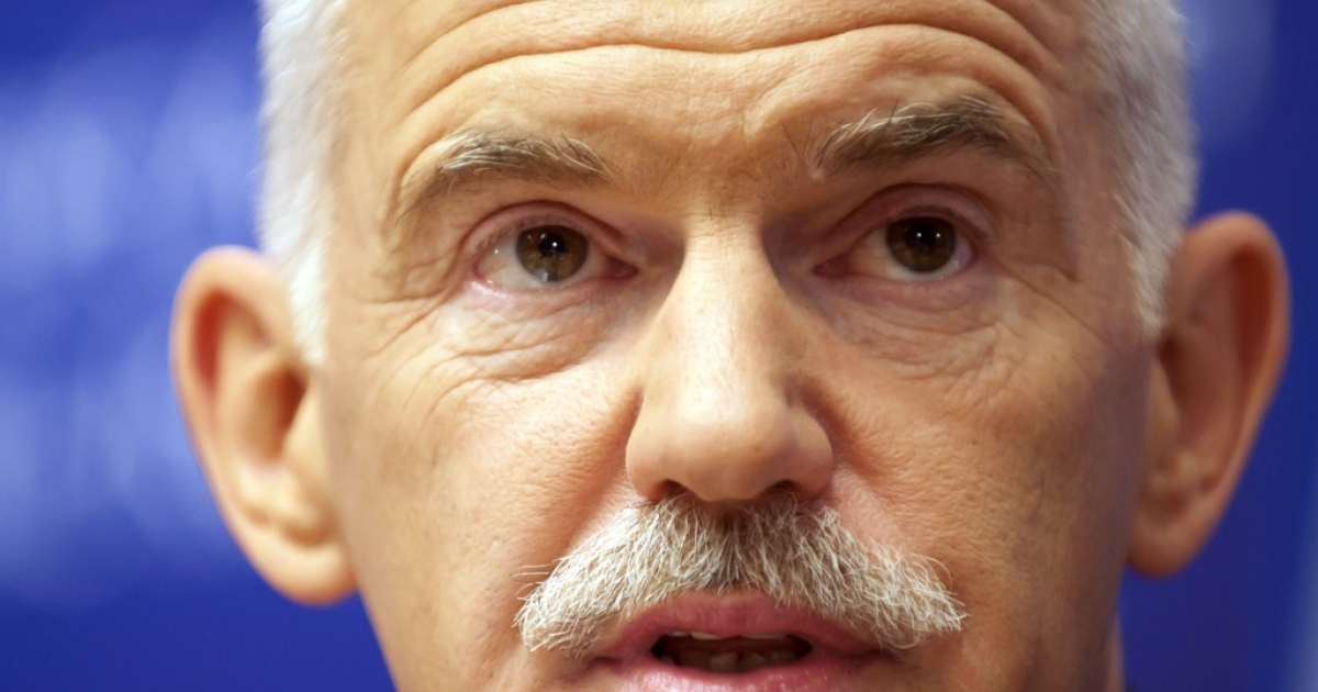 Greek Prime Minister George Papandreou addresses a press conference at the end of a summit of the EU heads of State on June 24, 2011 in Brussels.</p>