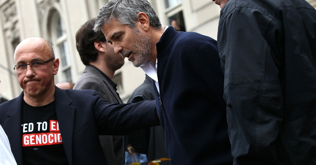 Actor George Clooney is arrested during a demonstration outside the Embassy of Sudan March 16, 2012 in Washington, DC. United to End Genocide, the Enough Campaign and Amnesty International held a rally to call on the United States and world leaders to stop the violence in South Sudan and prevent hundreds of thousands of people from starving.</p>