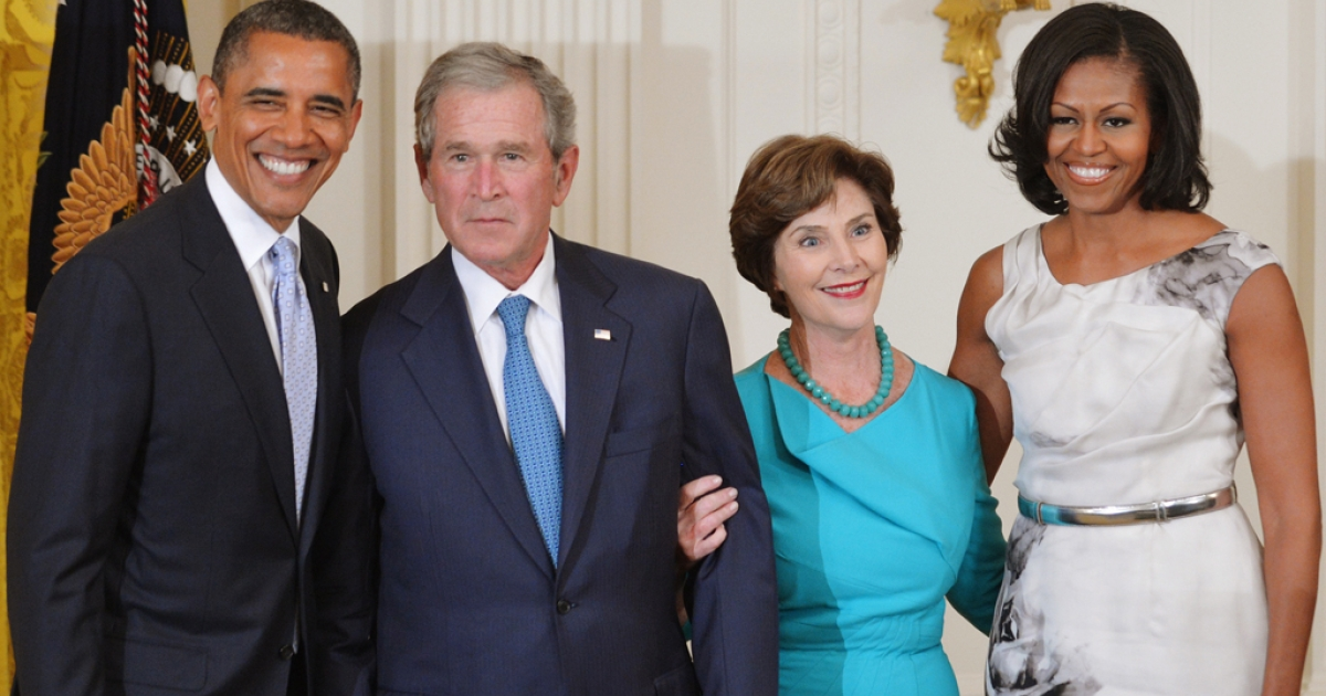 US President Barack Obama (L) and First Lady Michelle Obama (R) pose with former US president George W. Bush and his wife Laura Bush during the unveiling of their portraits May 31, 2012 in the East Room of the White House in Washington, DC.</p>