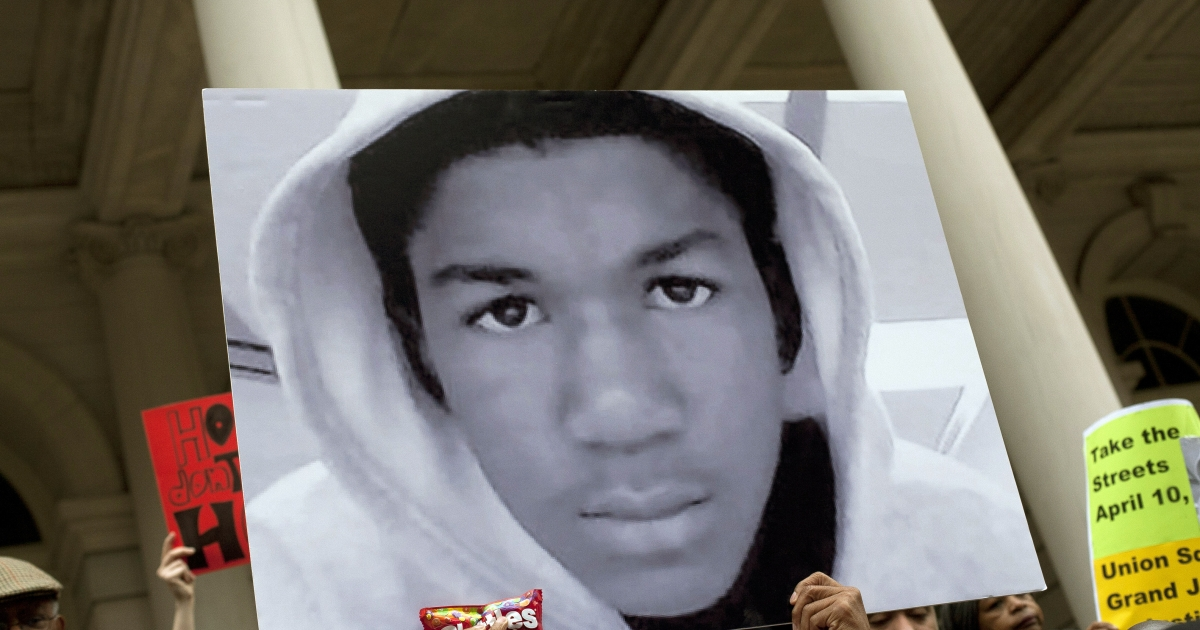 A photograph of Trayvon Martin is held at a news conference at City Hall today in New York City where City Council members and others called for justice in the teenagers Feb 26 killing.</p>