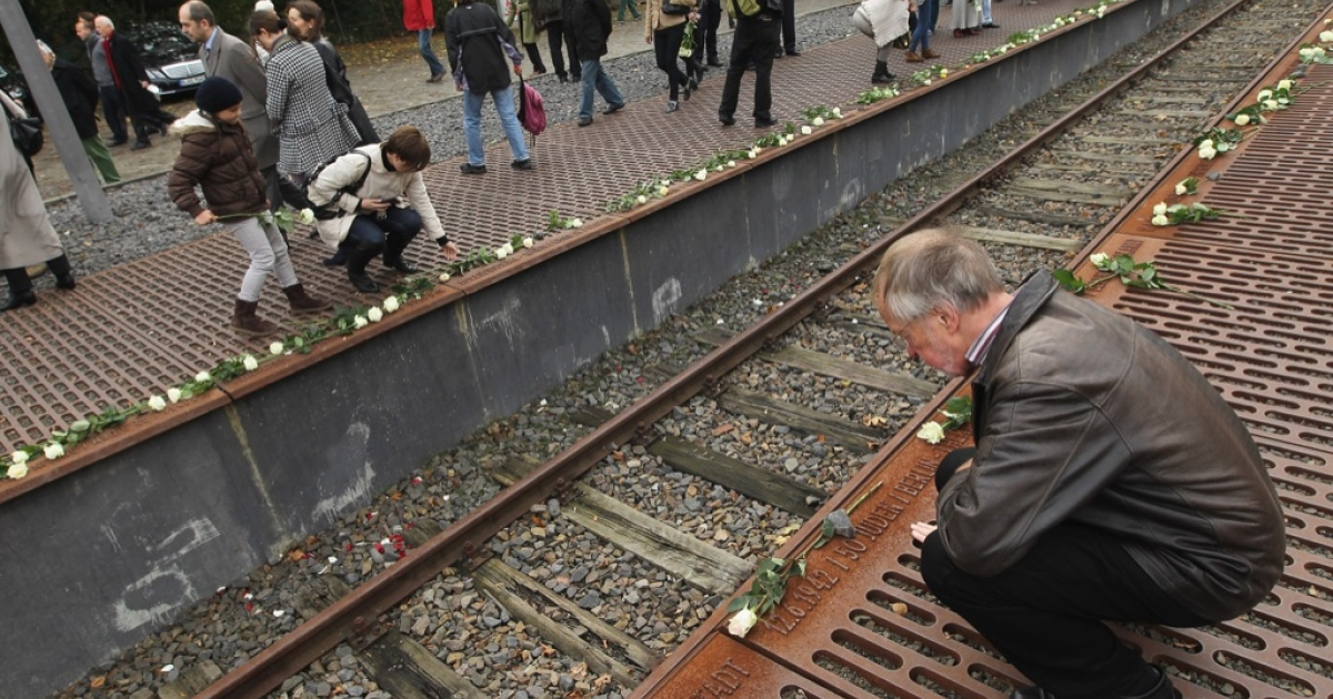 People arrive to lay roses at the Gleis 17 (Track 17) memorial on the 70th anniversary of the deportation of Jews from Berlin to concentration camps during World War II on Oct. 18, 2011 in Berlin, Germany. On Oct. 18, 1941, the Nazis began deporting Jewish residents of Berlin by rail to concentration camps, including to Theresienstadt and later to Auschwitz. Track 17, the original platform from which many Jews were crowded into freight cars for deportation, lists the dates, origins, destinations and numbers of Jews transported.</p>