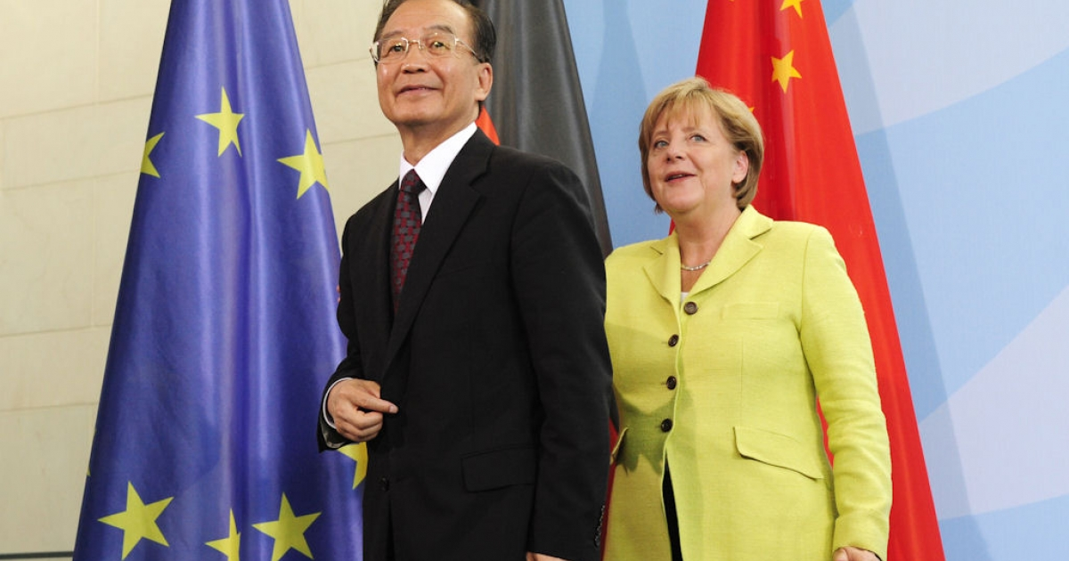 Chinese Prime Minister Wen Jiabao and German Chancellor Angela Merkel leave after a joint press conference in Berlin on June 28, 2011, after Germany's and China's first joint cabinet meeting.</p>