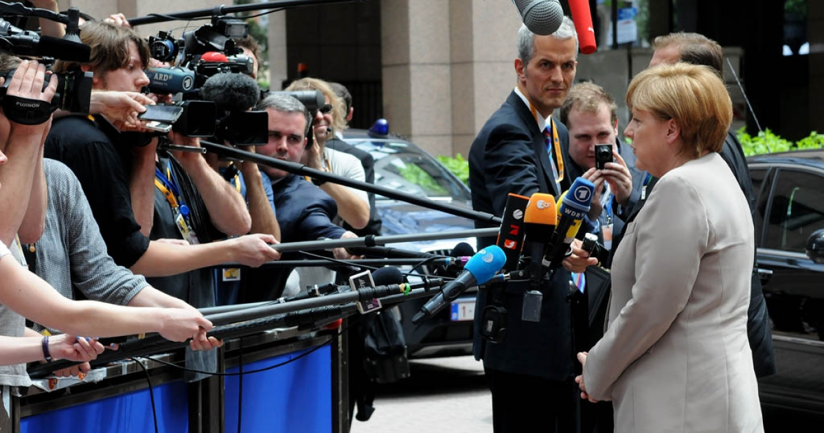 German Chancellor Angela Merkel talks to media prior to a meeting of European Union leaders in Brussels on June 28, 2012. Germany's finance ministry says it will remain a