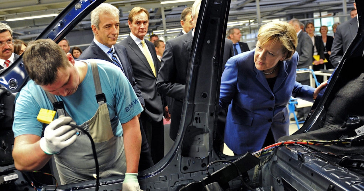 German Chancellor Angela Merkel (right) visit a BMW plant in Leipzig on Nov. 5, 2010. The plant will be expanded to produce the newly-developed Megacity electric car.</p>