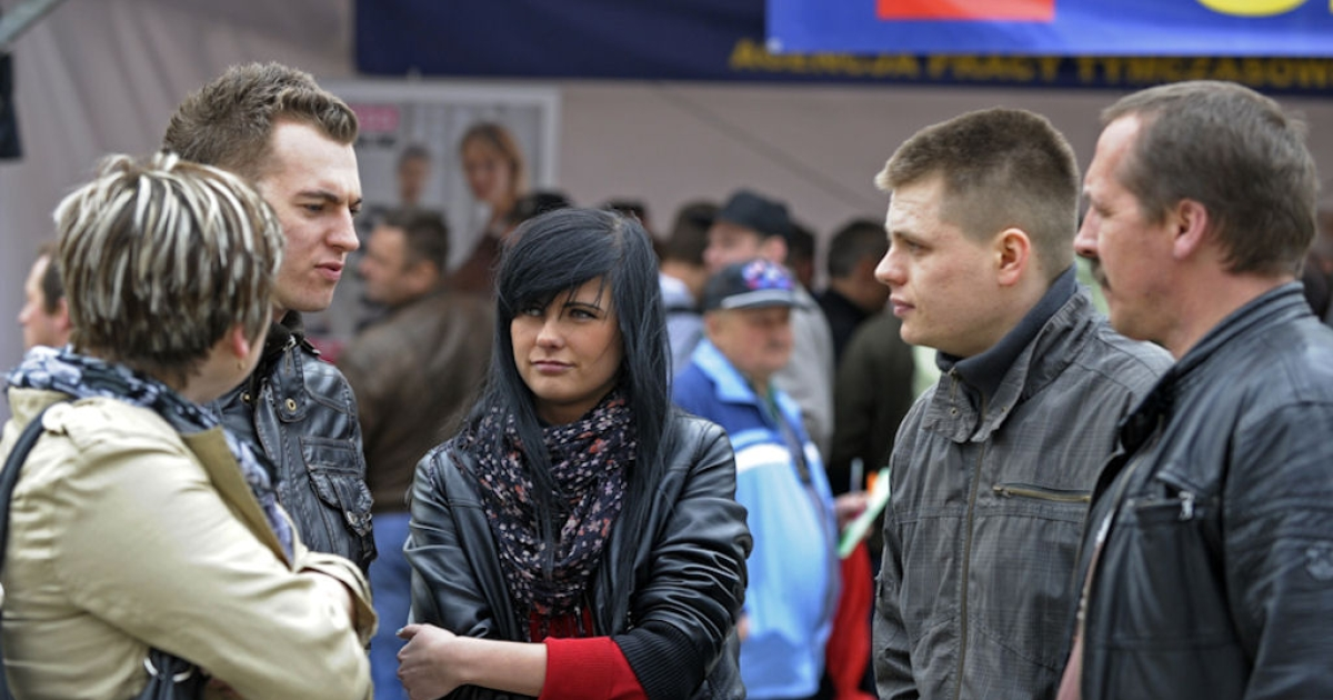 People chat on April 12, 2011 during a job fair in Wroclaw, Poland. Once feared by workforces in Austria as well as Germany, the proverbial Polish plumber is now being wooed as Vienna and Berlin seek to top up a shortage of skilled laborers as they fully open their job markets on May 1 to the eastern members who joined the EU in 2004.</p>