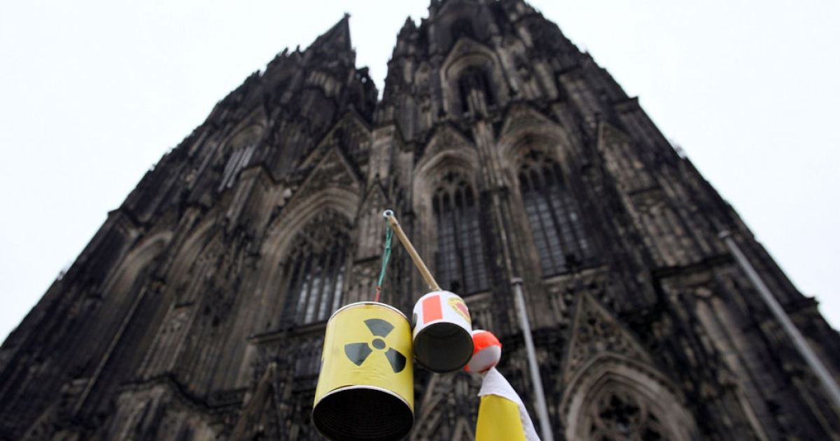 The Cologne cathedral and a sign referring to the nuclear disaster at the Fukushima facility in Japan during an anti-nuclear demonstration on March 14, 2011 in Cologne, Germany. Thousands of anti-nuclear demonstrators gathered in a coordinated effort in cities across Germany to protest against the government-granted extension of the operational lives of Germany's older nuclear power plants.</p>
