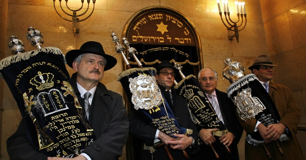 Members of Munich's Jewish community bring the Torah scroll to the new synagogue in Munich, southern Germany, ahead of its official inauguration on Nov. 9, 2006, 68 years to the day after a Nazi mob destroyed Munich's main synagogue. A new study finds high levels of anti-Semitism in mainstream German culture.</p>