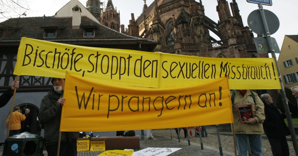 Protesters hold a banner which reads 'Bishops, stop the sexual abuse' in the southern German city of Freiburg on February 22, 2010.</p>