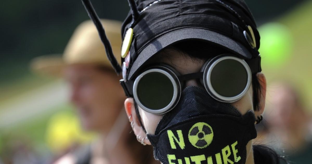A demonstrator attends a protest on May 22, 2011, in Dottingen, northern Switzerland against nuclear power.</p>