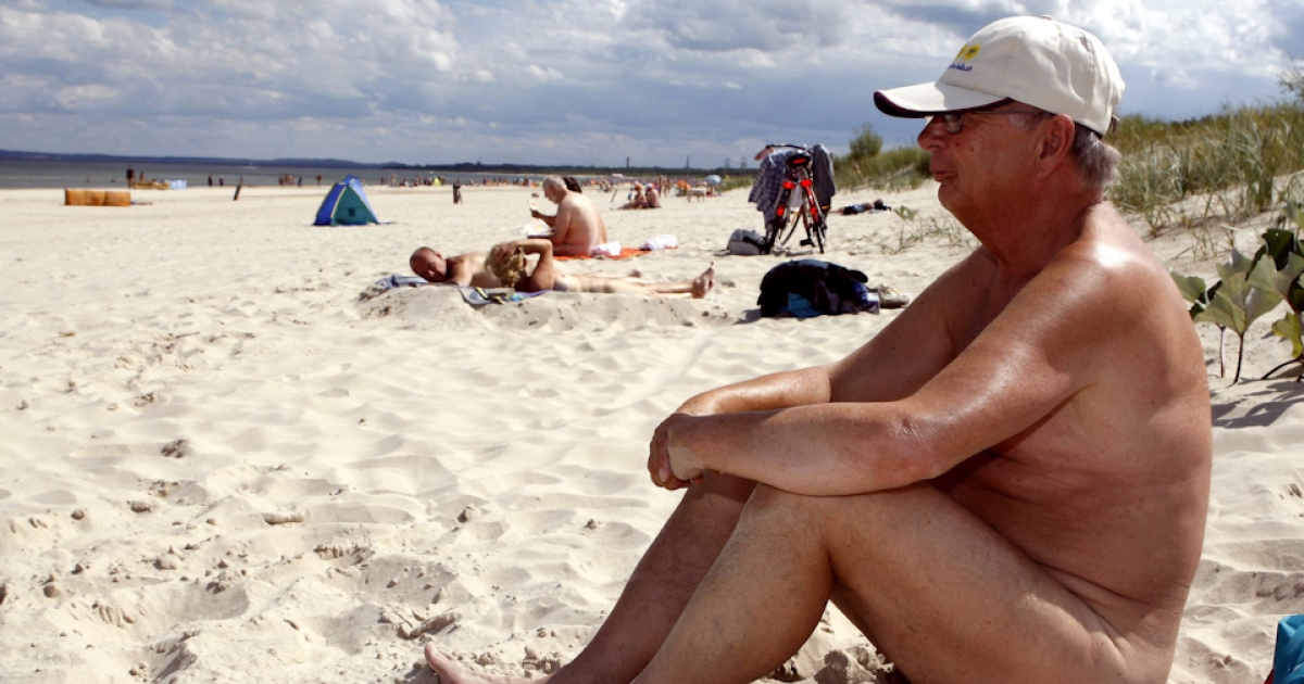 Wisconsin on Tuesday shut down Mazomanie Beach, a nudist hotspot, during weekdays in a bid to curb illegal sex and drug use. Here, a man sits on a nudist beach on the Baltic Sea coast in northern Germany.</p>