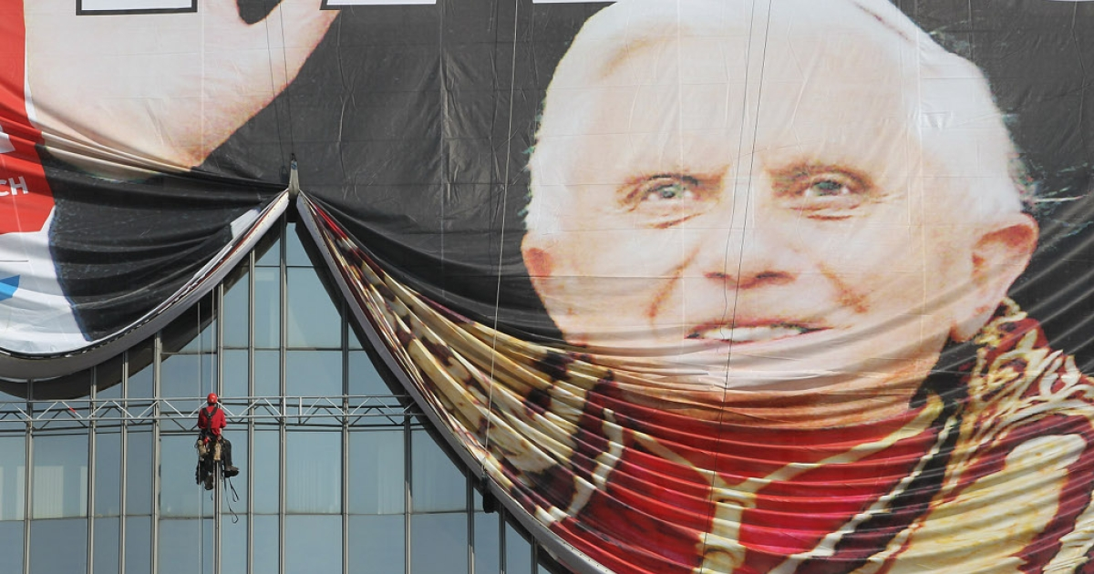 Protests are expected during the visit of Pope Benedict XVI to German, Sept. 22-25. In Berlin Germany on Sept. 20, on the facade of the Axel Springer Verlag headquarters, workers unfurl a giant reproduction of the front page of tabloid Bild Zeitung the day after German Cardinal Joseph Ratzinger was appointed Pope Benedict XVI.</p>