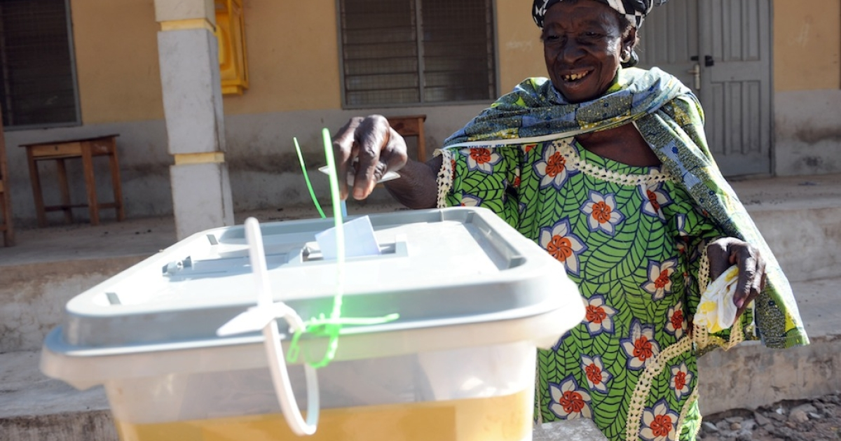 An elderly woman casts her ballot at the Bole polling station, in the Bole Bamboi constituency of northern Ghana, on December 7, 2012.  Ghana voted in a high-stakes presidential election today which is expected to be close, with the emerging country seeking to live up to its promise as a beacon of democracy in turbulent West Africa.</p>