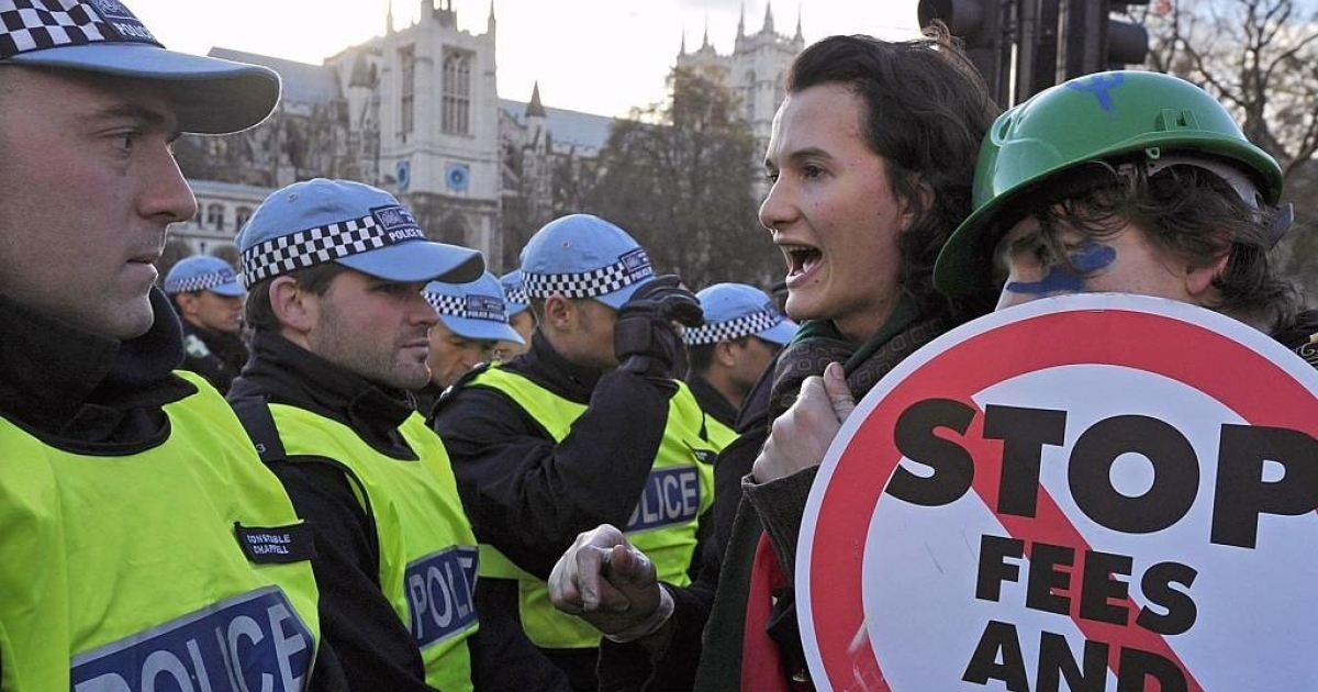 Charlie Gilmour (2nd R), son of Pink Floyd guitarist David Gilmour, speaks with police during student protests against the rise in tuition fees in central London on December 9, 2010.</p>