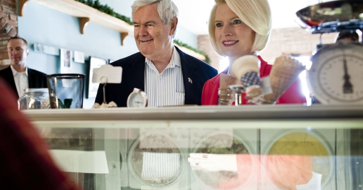 Newt Gingrich, former Speaker of the House, center, and his wife Callista, right, consider their ice cream options before leaving a campaign stop at Elly's Tea in Muscatine, Iowa on the day of the Iowa Caucus.</p>