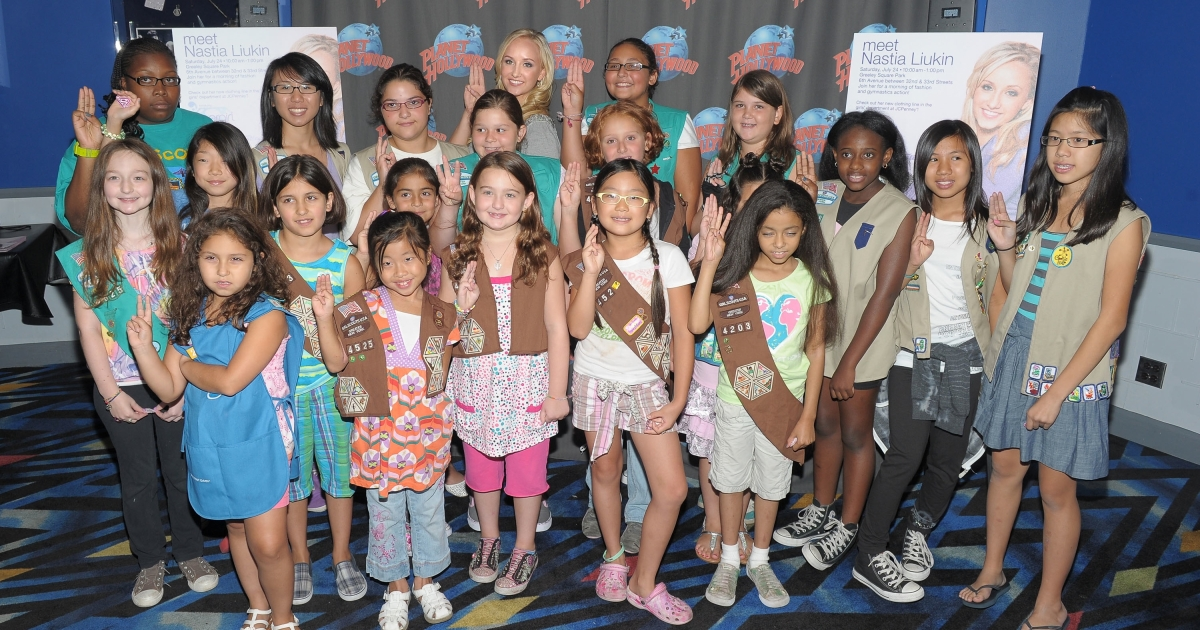 A Girl Scouts troop meets gymnast Nastia Liukin at Planet Hollywood Times Square in New York City in July 2010. An Indiana lawmaker says he can't support a proclamation honoring the group's 100th anniversary because they are destroying